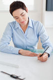 Woman working on an architectural plan Stock Photography