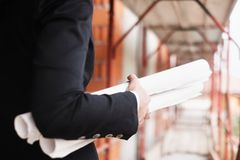 Woman Working As Engineer Holding Building Plans stock photography