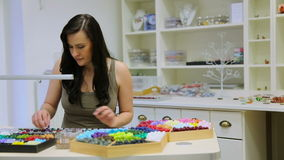 Woman working as a jewelry designer stock video footage
