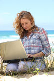 Woman working on the beach Royalty Free Stock Images