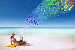 Woman working on the beach stock photos