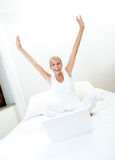 Woman working on bed. Woman with laptop on bed Stock Photo