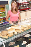 Woman Working Behind Counter In Cafe Royalty Free Stock Image