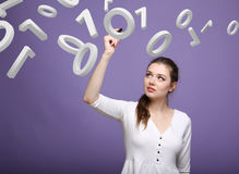 Woman working with binary code, concept of digital technology. Royalty Free Stock Photo
