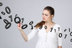 Woman working with binary code, concept of digital technology. Stock Photography