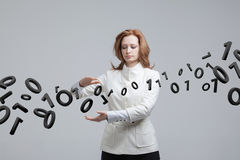Woman working with binary code, concept of digital technology. Royalty Free Stock Image