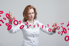 Woman working with binary code, concept of digital technology. Stock Images