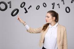 Woman working with binary code, concept of digital technology. Stock Image