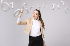 Woman working with binary code, concept of digital technology. Royalty Free Stock Images