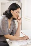 Woman working on Blueprints Stock Photo