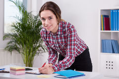 Woman working in bureau Royalty Free Stock Photo