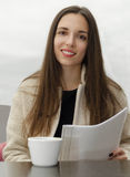 Woman working with a business paper lunch. Woman working with a business papers at the lunch Stock Photography