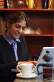 Woman working in a Cafe Royalty Free Stock Image