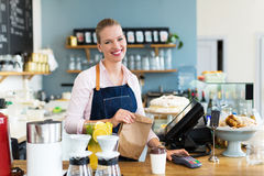 Woman working at cafe. Young woman working at cafe Royalty Free Stock Photography