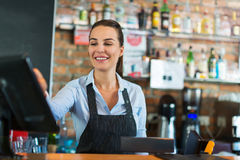 Woman working at cafe Stock Photos