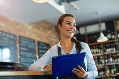 Woman working at cafe Royalty Free Stock Image