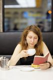 Woman working in a cafe Stock Photo