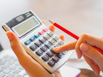 Woman working with calculator,. Business document and laptop computer notebook Royalty Free Stock Photos