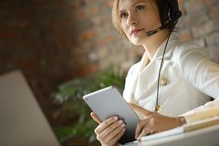 Dispatcher at work. Woman working in call center as dispatcher Stock Photography