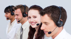 Woman working in a call center with her colleagues Royalty Free Stock Photos