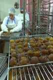 Woman working in a candied chestnut factory Stock Photography