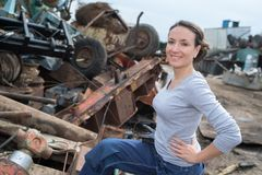 Woman working at car scrapper. Woman working at a car scrapper Stock Images