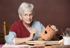 Woman working with clay Royalty Free Stock Photo