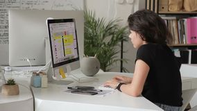 Woman working closely in front of monitor in office. Schedule of planning. stock video