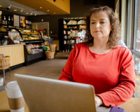 Woman working in coffee shop Royalty Free Stock Photo