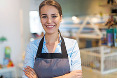 Woman working in coffee shop Royalty Free Stock Images