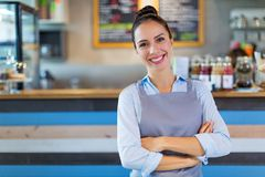 Woman working in coffee shop Royalty Free Stock Image