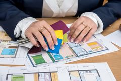 Woman working with color palette with house plan. Woman working with color palette with house plan stock photography