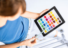 Woman working with color samples Stock Images