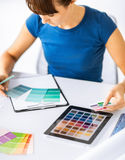Woman working with color samples for selection Stock Photography