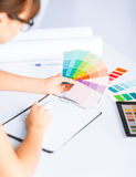 Woman working with color samples for selection Royalty Free Stock Photos