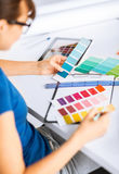 Woman working with color samples for selection Stock Photo