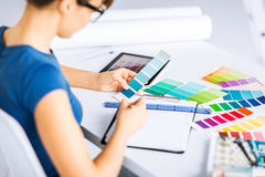 Woman working with color samples for selection Royalty Free Stock Image