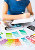 Woman working with color samples for selection stock images