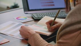 Woman working with color samples for selection. Interior design and renovation concept - woman working with color