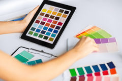 Woman working with color samples for selection Stock Photos