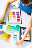 Woman working with color samples for selection Royalty Free Stock Images