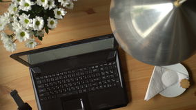 A Woman Working At Computer With Coffee And Bouquet Of Flowers On The Table. stock video footage