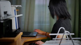Woman working with computer stock video footage