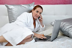 Woman working with computer in her room Royalty Free Stock Images
