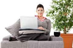 Woman working on computer at home Stock Photo