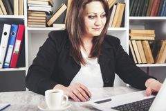 Woman working in computer keyboard stock images