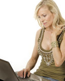 Woman working on computer laptop Stock Photography