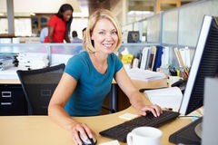 Woman Working At Computer In Modern Office royalty free stock photography