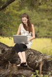 Woman working on computer in nature Stock Image