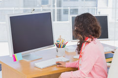 Woman working in a creative office Stock Image
